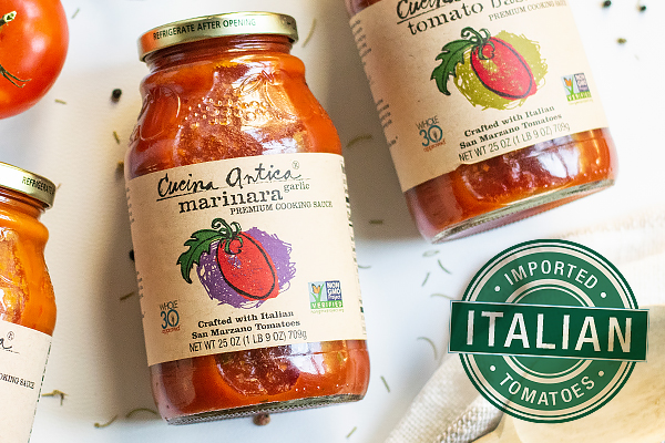"Three jars of Cucina Mariana sauce with a green badge that say ""Imported Italian Tomatoes"""