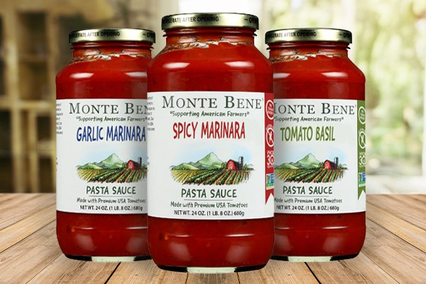 Three jars of Monte Bene pasta sauce on top a wooden table