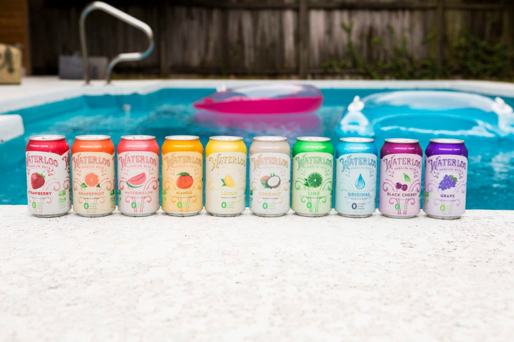 Waterloo sparkling water flavors lined up by a pool