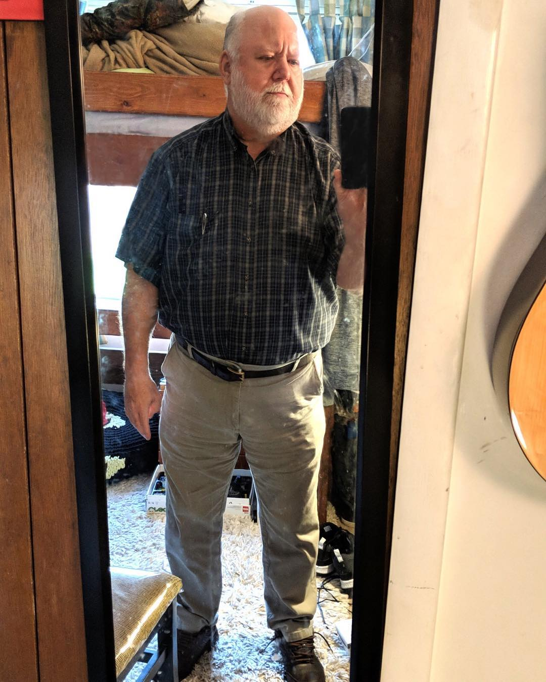 Greg in his room taking a photo of himself in the mirror