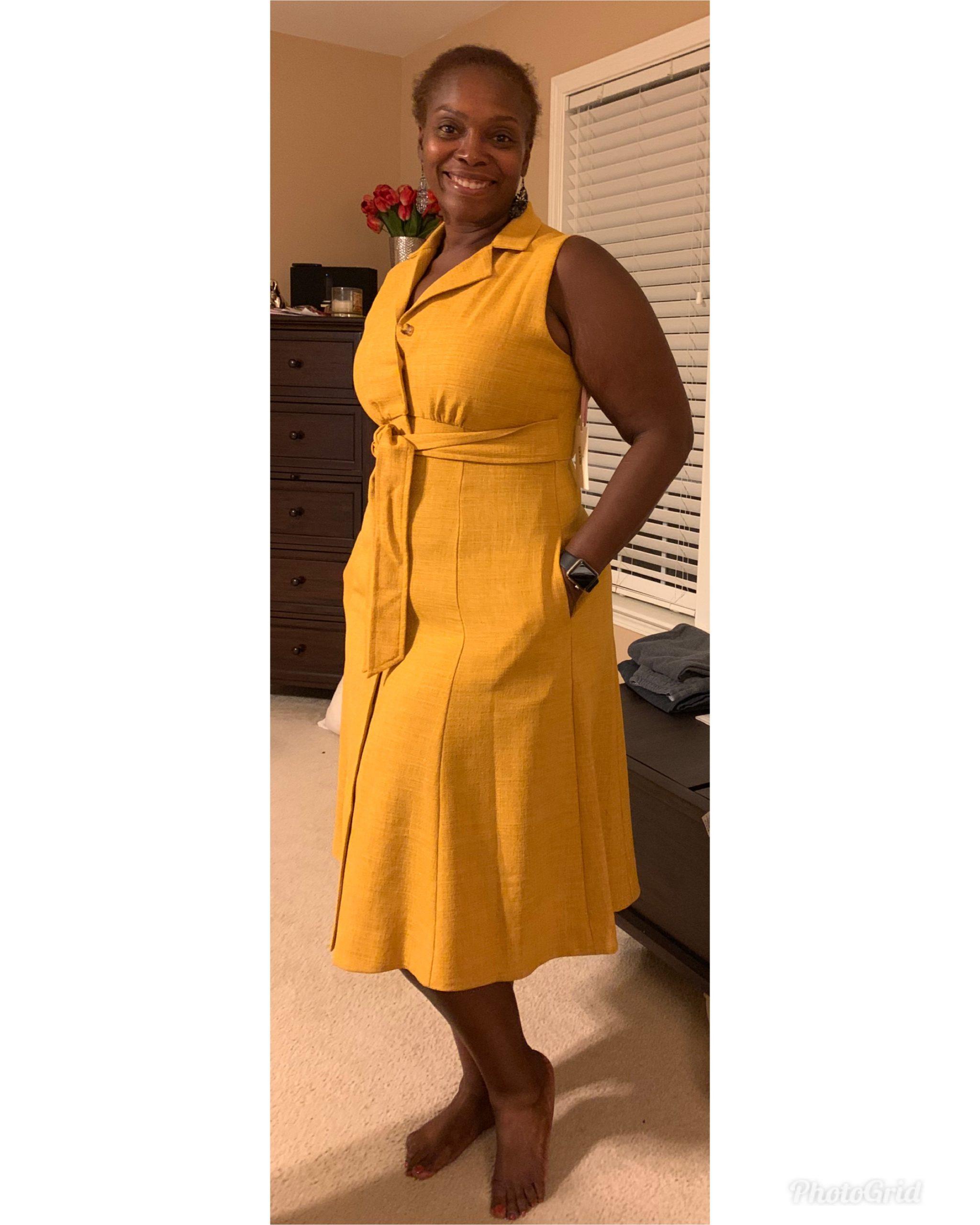 Jakelia Sledge in a yellow dress smiling