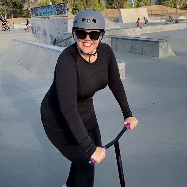 Holly on a scooter at a skate park