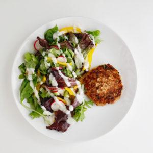 Salmon patties with salad