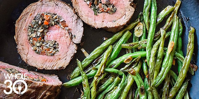 Mushroom stuffed beef roulade with green beans