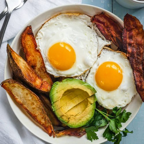 Breakfast bowl with potatoes, avocados, eggs sunny-side up