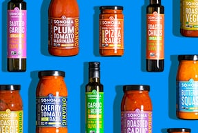 Assortment of Sonoma Gourmet sauces on a bright blue background