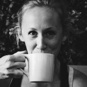 Amy Hester sipping out of a coffee mug
